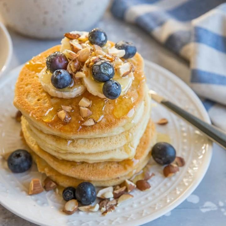 stack of almond flour pancakes with honey drizzle