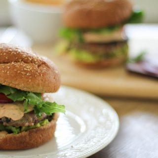 Southwest Turkey Burgers with Chipotle Yogurt Sauce | https://www.theroastedroot.net