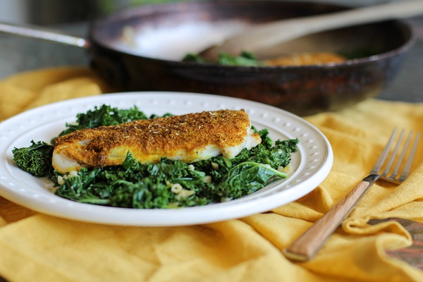Curry-Spiced Sole with Garlic Sautéed Kale | https://www.theroastedroot.net