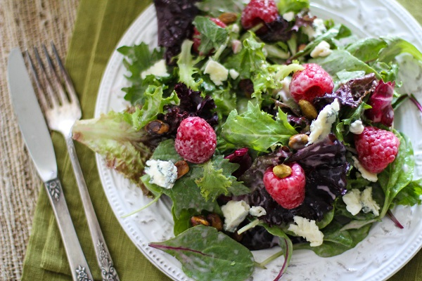 Raspberry Pistachio Salad with Creamy Raspberry Vinaigrette | http://www.theroastedroot.net