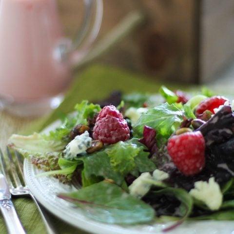 Raspberry Pistachio Salad with Creamy Raspberry Vinaigrette   https://www.theroastedroot.net