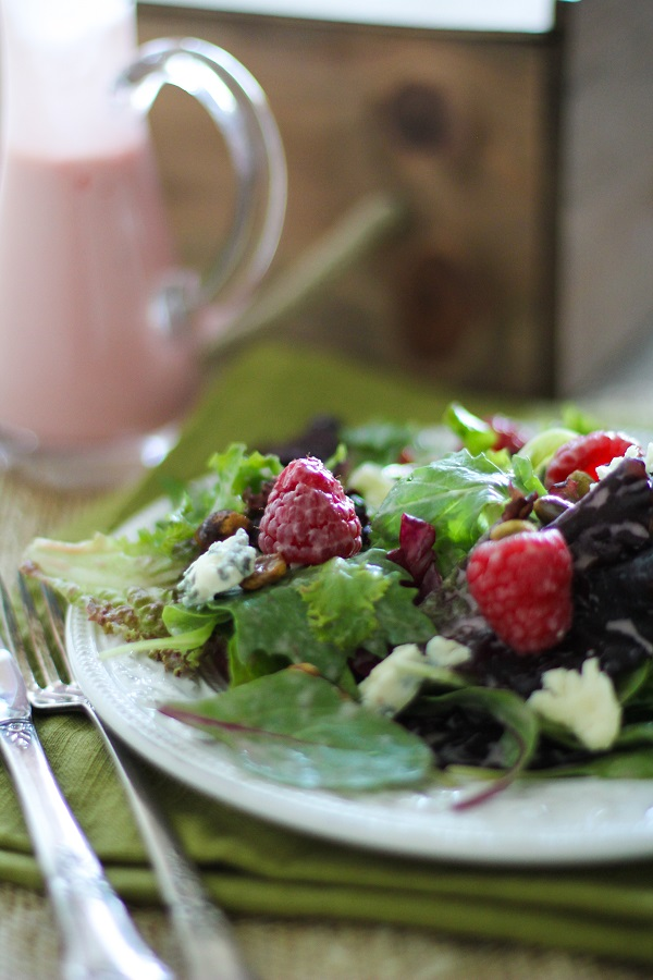 Raspberry Pistachio Salad with Creamy Raspberry Vinaigrette | https://www.theroastedroot.net