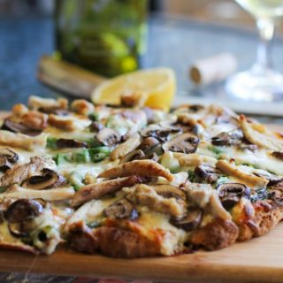 Roasted Chicken & Mushroom Pizza with spinach and kale pesto sauce | https://www.theroastedroot.net