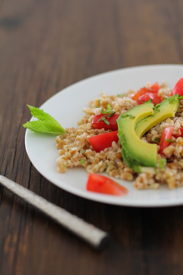 Heirloom Tomato and Avocado Farro Salad with Mint-Lime Dressing | https://www.theroastedroot.net