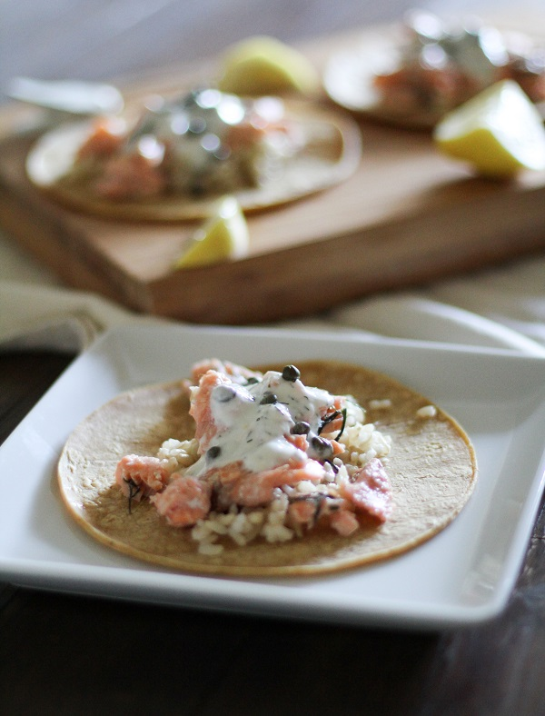 Salmon Tacos  with Caper-Dill Yogurt Sauce - - - > https://www.theroastedroot.net