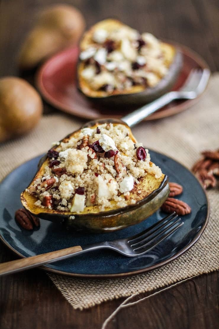 Quinoa-Stuffed Acorn Squash with pears, pecans, dried cranberries, feta, cinnamon, and orange zest - an easy, delicious vegetarian meal | TheRoastedRoot.net #vegetarian #vegan