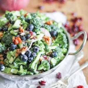 Healthier Broccoli Salad with Yogurt Dressing, blueberries, cranberries, bacon, and honey-toasted walnuts