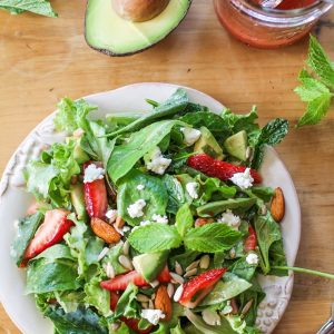 Baby Kale Salad with Strawberry-Mint Vinaigrette, goat cheese, walnuts, and avocado - a healthy and delicious summer salad recipe