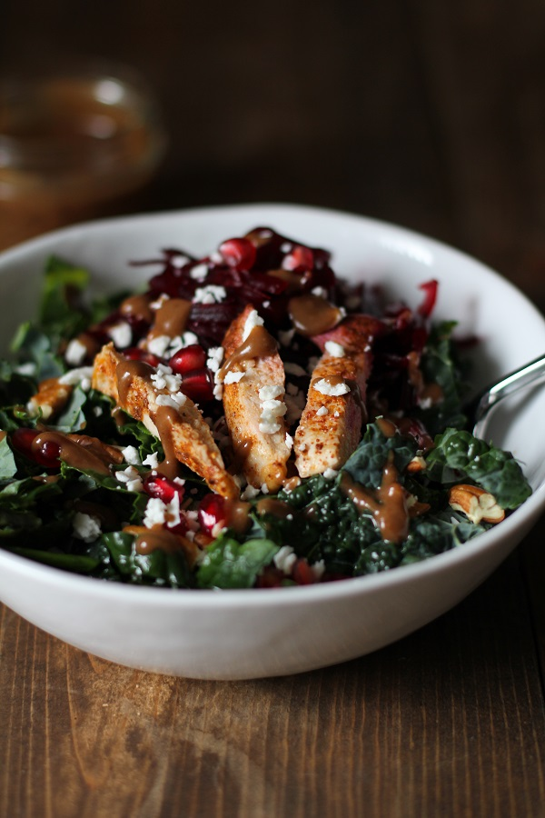 Chili Chicken Kale Salad with pomegranate seeds, pecans, goat cheese, shredded beets, and cinnamon dijon balsamic vinaigrette