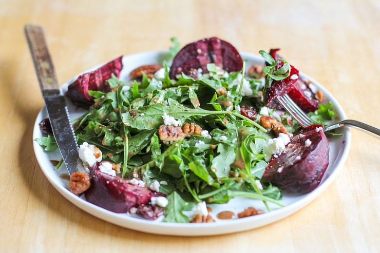 Roasted Beet Arugula Salad with balsamic vinaigrette, pecans, and goat cheese