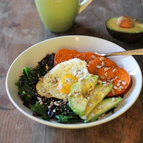 Well-Balanced Sweet Potato Breakfast Bowls with Spinach, Avocado, and Sunflower Seeds   theroastedroot.net @roastedroot #vegetarian #breakfast #recipe
