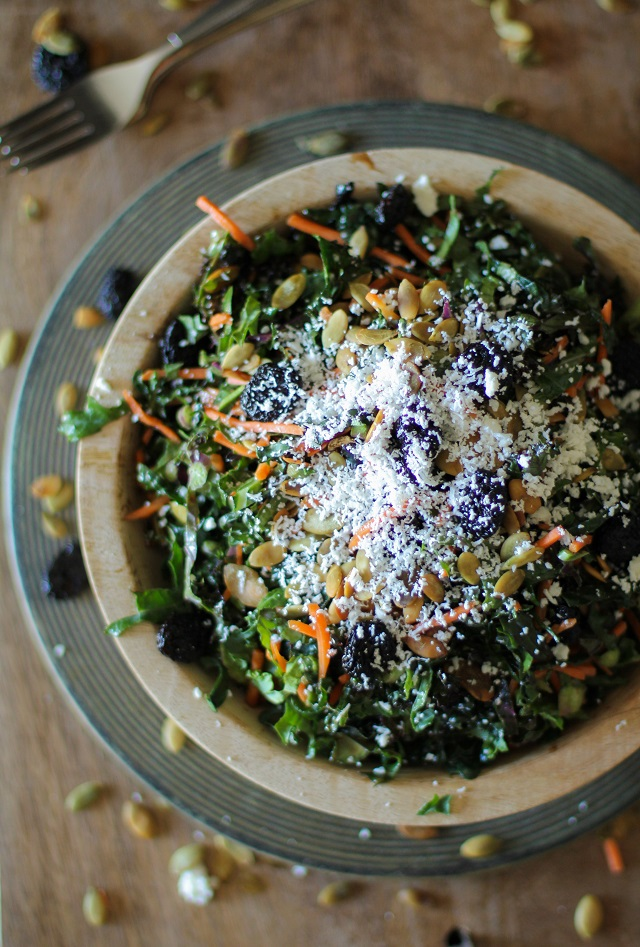 Kale Salad with Pumpkin Seeds, Dried Cherries, Cotija Cheese, and Lemon-Parsley Dressing | theroastedroot.net #letthemeatkale #healthy #recipe