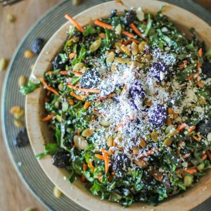 Kale Salad with Dried Cranberries, Pumpkin Seeds, Cotija Cheese, and Lemon Parsley Dressing