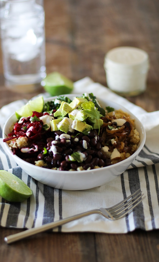 Quinoa, beet, and black bean burrito bowls with caramelized onions and cumin-lime tahini | theroastedroot.net #vegan #vegetarian #recipe #paleo #healthy @roastedroot