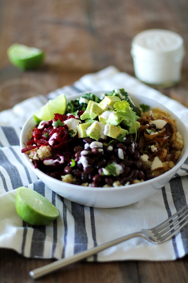 Quinoa, beet, and black bean burrito bowls with caramelized onions and ...