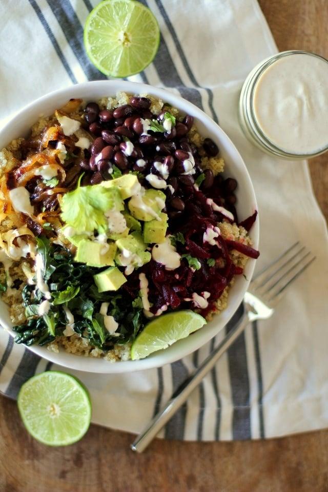 Quinoa, beet, and black bean burrito bowls with caramelized onions and cumin-lime tahini   theroastedroot.net #vegan #vegetarian #recipe #paleo #healthy @roastedroot