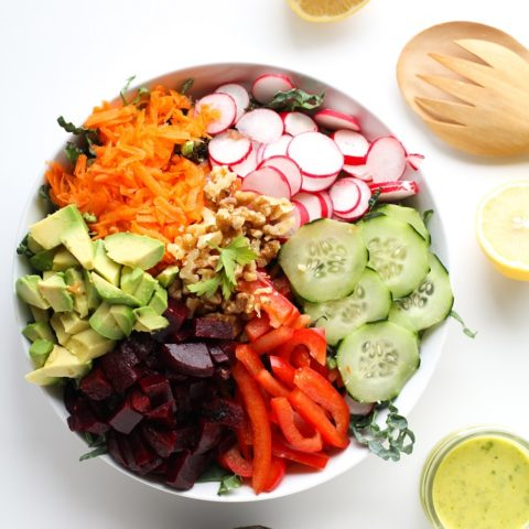 Spring Cleaning Detox Salad with kale, bell pepper, radishes, carrots, beets, avocado, walnuts, and lemon-parsley vinaigrette | theroastedroot.net #vegan #vegetarian #detox #salad #cleaneating #letthemeatkale