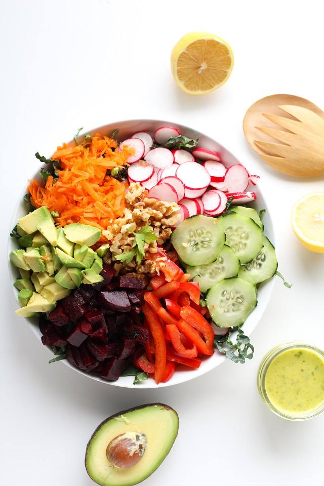 Spring Cleaning Detox Salad with kale, bell pepper, radishes, carrots, beets, avocado, walnuts, and lemon-parsley vinaigrette | theroastedroot.net #vegan #vegetarian #detox #salad #cleaneating #letthemeatkale