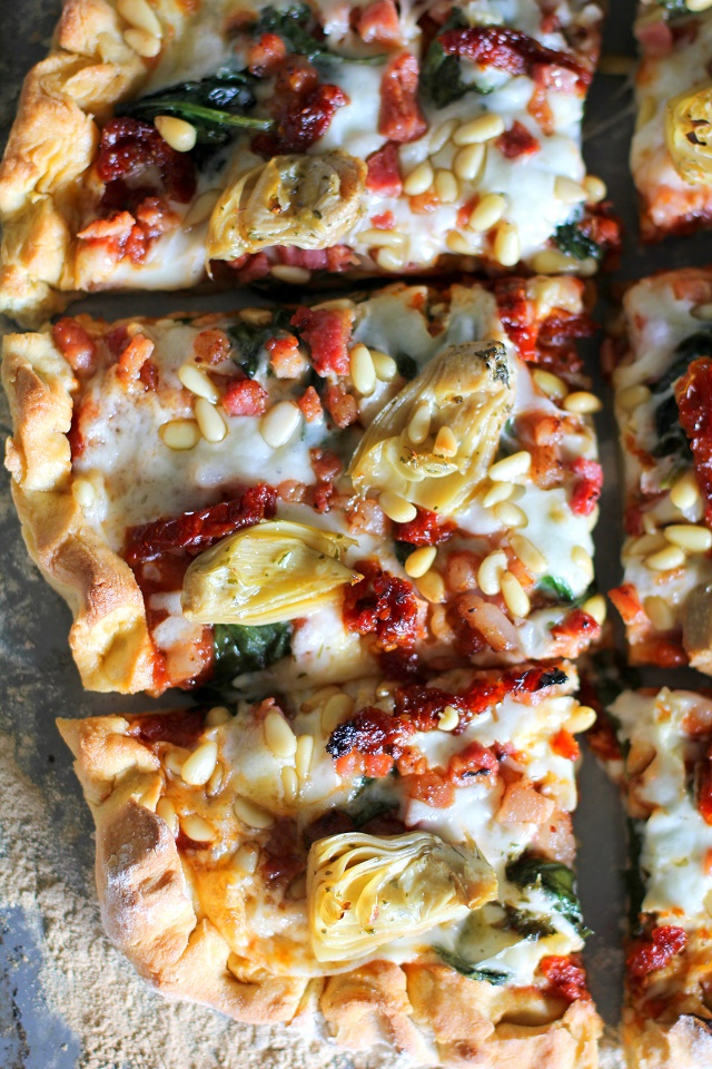 Prosciutto, Artichoke Heart, and Sun-Dried Tomato Pizza with Pine Nuts and Spinach | theroastedroot.net #glutenfree #pizza @bobsredmill @roastedroot