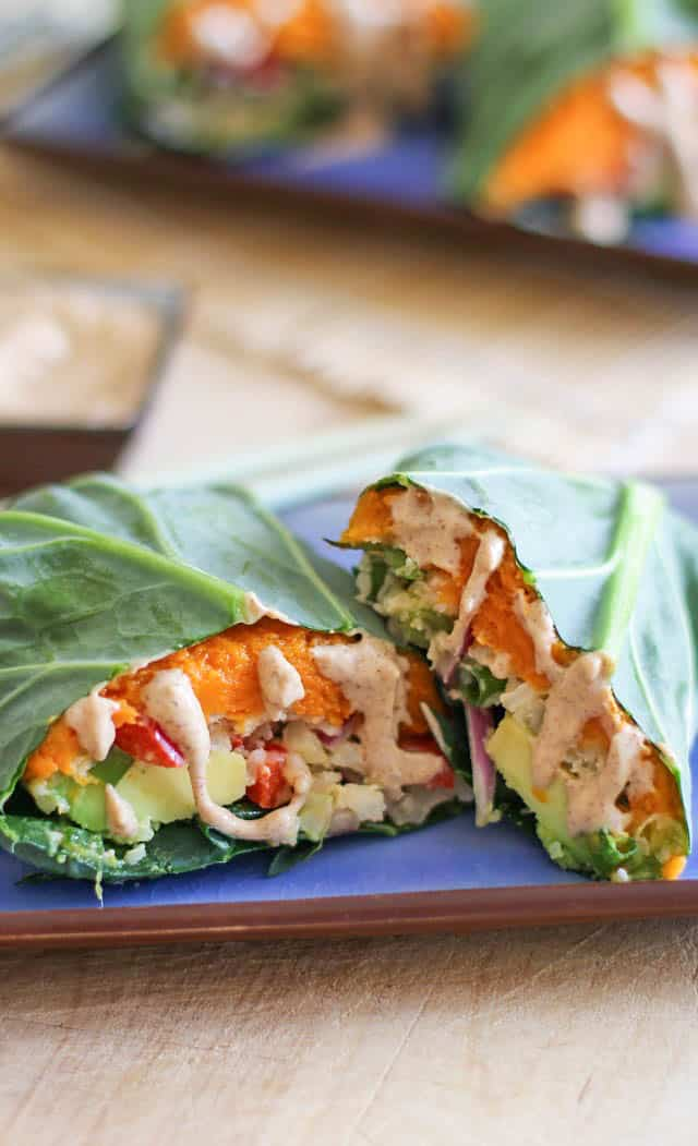 Roasted Sweet Potato and Cauliflower Rice Collard Wraps with avocado and almond ginger sauce - these healthy vegan wraps are perfect for lunch!