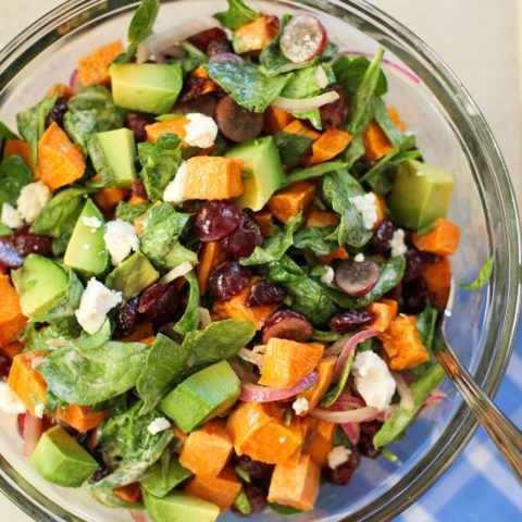 Roasted Sweet Potato Salad with Spinach, Grapes, Dried Cranberries, and Avocado | theroastedroot.net