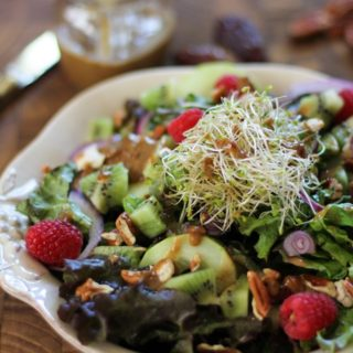 Spring Green Salad with Kiwi, Raspberries, and Date-Balsamic Vinaigrette