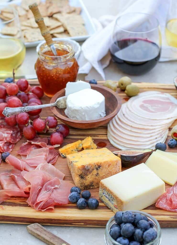 How to Make a Charcuterie Board - tips for selecting meat, wine and cheese pairings, as well as incorporating seasonal ingredients