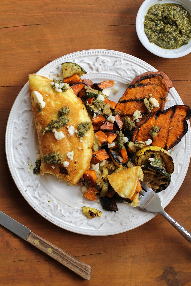 Leftover Grilled Vegetable Omelet with Pesto Sauce and Feta Cheese + 10 ideas for using your leftover grilled vegetables and meats | TheRoastedRoot.net