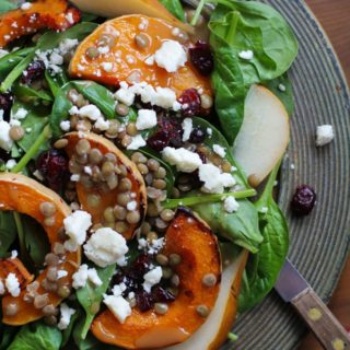 Roasted Butternut Squash and Pear Salad with lentils, feta cheese, dried cranberries, and citrus sage vinaigrette | TheRoastedRoot.net #healthy #superfood #salad #recipe #fall