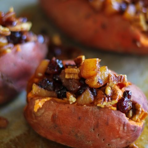 Stuffed Sweet Potatoes with yogurt, caramelized pears, pecans, and dried cranberries #healthy #sidedish #recipe #holiday #Thanksgiving TheRoastedRoot.net