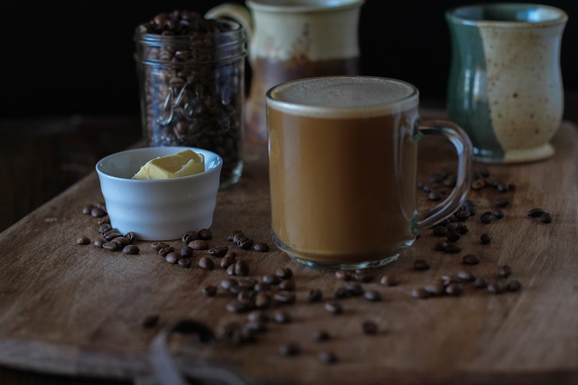 Bulletproof Coffee - brewed coffee + grassfed butter + coconut oil blended together in a blender makes a frothy latte! | TheRoastedRoot.net #paleo #recipe #healthy #drink