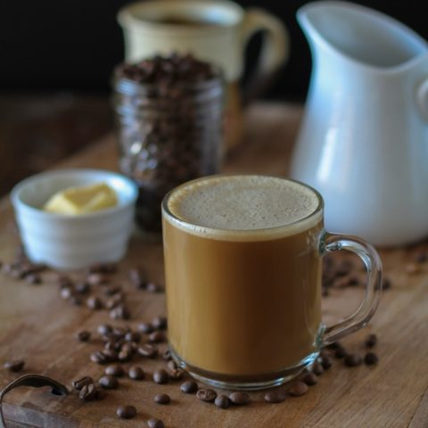 Bulletproof Coffee - brewed coffee + grassfed butter + coconut oil blended together in a blender makes a frothy latte!   TheRoastedRoot.net #paleo #recipe #healthy #drink