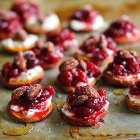 Sweet Potato Rounds with Goat Cheese, Roasted Cranberries, @bluediamond almonds, and honey TheRoastedRoot.net #healthy #appetizer