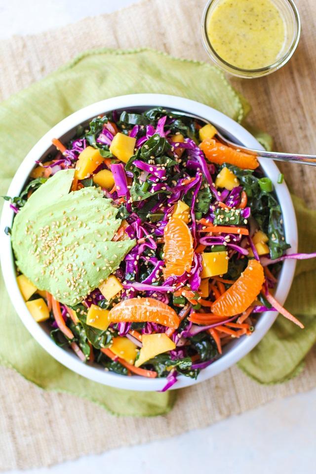 Crunchy Kale and Mandarin Salad with Avocado, Mango, and Lemon Poppy Seed Dressing | TheRoastedRoot.net #superfood #vegan #recipe #paleo