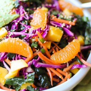 Crunchy Kale and Mandarin Salad with Avocado, Mango, and Lemon Poppy Seed Dressing   TheRoastedRoot.net #superfood #vegan #recipe #paleo