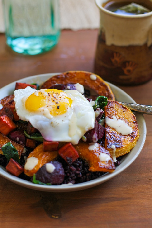 Roasted butternut squash, beet, and sweet potato forbidden rice bowls with maple tahini sauce | TheRoastedRoot.net #healthy #recipe #vegetarian