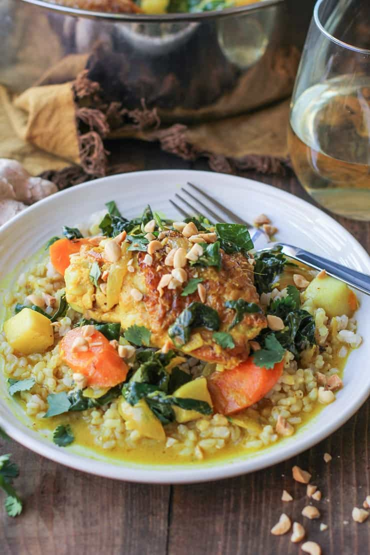 Ginger-Turmeric Braised Chicken with Rice and Root Vegetables - an incredibly nutritious one-pot meal. #paleo #healthy