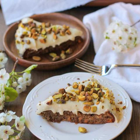 Grain-Free Vegan Carrot Cake - made with almond flour, flax eggs, and naturally sweetened with pure maple syrup | TheRoastedRoot.net #glutenfree #healthy #dessert #brunch