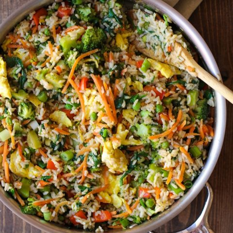 Fully-Loaded Vegetable Fried Rice with broccoli, carrot, bell pepper, spinach, and peas | TheRoastedRoot.net #healthy #recipe #vegetarian