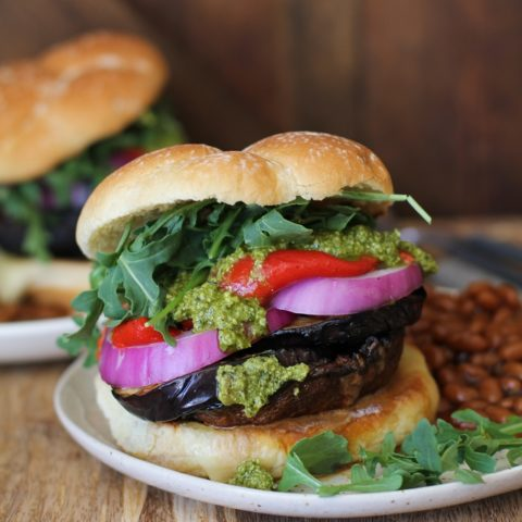 The Ultimate Grilled Portobello Burger with grilled eggplant, roasted red peppers, red onion, arugula, and pesto sauce | TheRoastedRoot.net #healthy #vegetarian #recipe