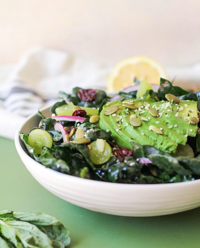 Lemon Basil Kale Salad with grapes, pumpkin seeds, and avocado | TheRoastedRoot.net #healthy #salad #recipe #detox #vegan #vegetarian