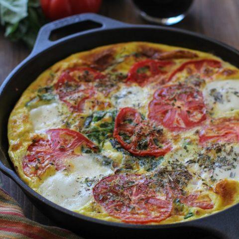 Caprese Frittata with Arugula | TheRoastedRoot.net #healthy #breakfast #dinner #vegetarian
