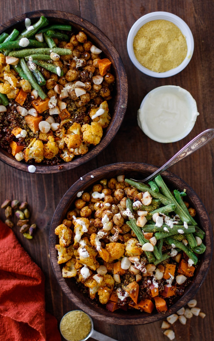 Roasted Vegetable Quinoa Bowls with Toasted Macadamia Nuts and Cashew Cream Sauce | TheRoastedRoot.net #healthy #vegetarian #vegan #glutenfree #recipe #paleo