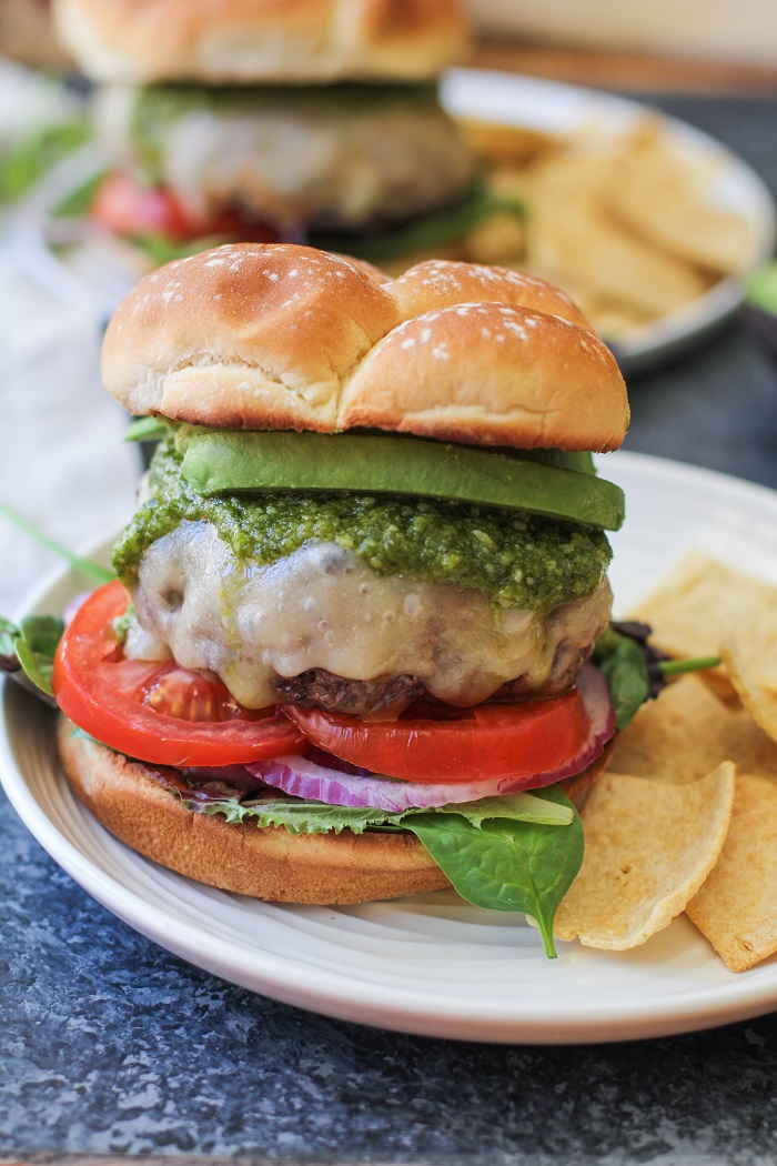 Skillet-Cooked Bison Burgers with Havarti Cheese and Pesto Sauce | TheRoastedRoot.net #recipe #burger #dinner