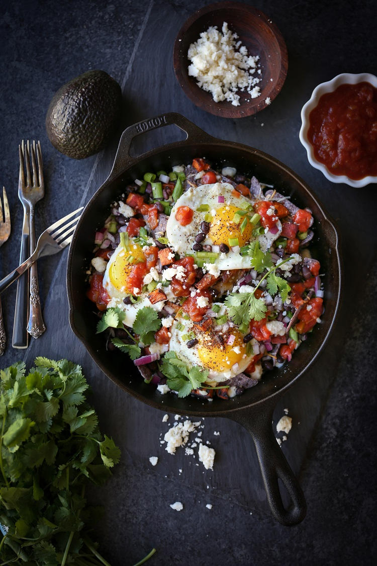 Sweet Potato Huevos Rancheros Nachos with black beans, avocado, sunny side up eggs, salsa, and more | TheRoastedRoot.net #dinner #breakfast #brunch #footballfood #glutenfree #appetizer
