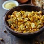 """Cheesy"" Vegan Roasted Cauliflower with Nutritional Yeast | TheRoastedRoot.net #healthy #recipe #vegetarian #glutenfree"