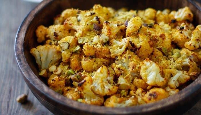 """Cheesy"" Vegan Roasted Cauliflower with Nutritional Yeast   TheRoastedRoot.net #healthy #recipe #vegetarian #glutenfree"