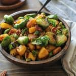 Cinnamon-Maple Sauteed Acorn Squash and Brussels Sprouts with Bacon | TheRoastedRoot.net #healthy #sidedish #paleo #holiday