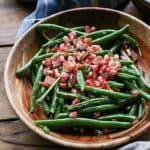 Pan-Fried Bacon Green Beans with Pomegranate Seeds - a healthful, festive side dish perfect for holiday gatherings | TheRoastedRoot.net #glutenfree #vegetables #thanksgiving