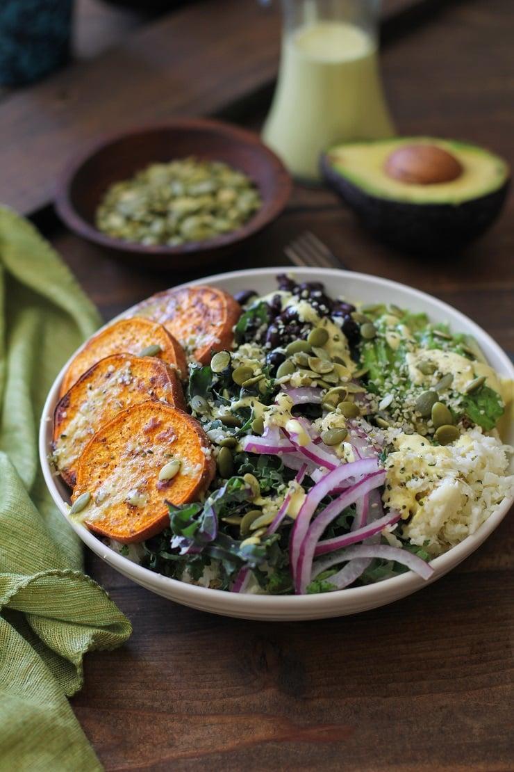 Roasted Sweet Potato and Cauliflower Rice Buddha Bowls with Turmeric Tahini Dressing | TheRoastedRoot.net #healthy #recipe #vegan #vegetarian